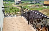 Кованое ограждение балкона второго этажа