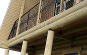 Балкон кованый в деревянном доме