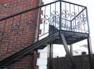Кованое ограждение металлической лестницы